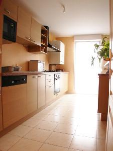 Appartement 80 m²  en rez  de chaussée haut